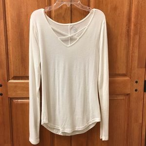 White long sleeve top with cross front